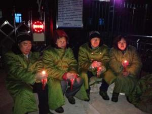 Lawyers and activists gather outside Qixing Detention Center in Jiangsanjiang, Heilongjiang, to protest unlawful detention of rights defense lawyers and citizens, March 25, 2014.